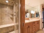 This ensuite also features a steam shower.