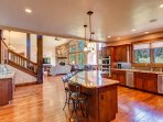 Large chef's kitchen with slab granite and stainless appliances
