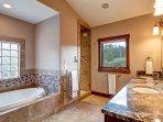 Large master bath with granite