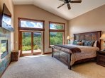 Bedroom #1 - Master suite with fireplace and access to patio