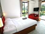Wake up and have private breakfast at masterbedroom s sofa with garden and blue Lagoon pool view, op