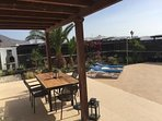 Shaded pergola with outdoor dining area, Garden with Palm Trees and Cacti, Stunning mountain views