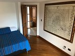 Third room with full bed and large framed map of old Amsterdam