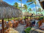 Have a meal at the popular Duke's beach house restaurant