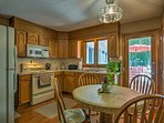 When hunger strikes, head into the fully equipped kitchen which boasts hardwood floors, ample counter space, and...