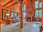 Vaulted ceilings and exposed beams create a warm and welcoming atmosphere.