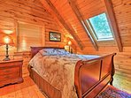 The lofted space has beautiful vaulted ceilings and wood-paneled walls.