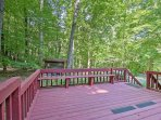 Spend some time on the expansive deck overlooking the surrounding woods.