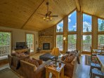 Floor-to-ceiling windows and numerous, large windows open up this 2,016-square-foot cabin.