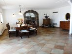 Living and dining area entrance villa located in a quiet position with pool and sea view amalficoast