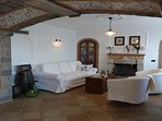 Living area with double sofabed, bathroom shower and fireplace sorrentocoast booking villas