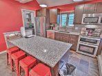 Lower Kitchen with Stainless Steel Appliances, including Electric range with Double Ovens, Granite Counters and Kitchen...