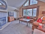 Lower Level Living Room with Comfortable Furnishings, Wood Fireplace, 48' Sony TV, and Blu-Ray Player