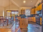 Fully Equipped Kitchen with Granite Countertops, Bar Seating and a Dining Area