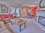 Lower Level Living Room with Comfortable Furnishings, Wood Fireplace, TV and Blu-Ray Player