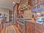 Master Chef's Kitchen with Viking Gas Stove and Sub Zero Refrigerator