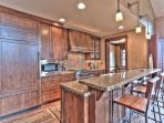 Master Chef's Kitchen with Viking Gas Stove, Sub Zero Refrigerator and bar seating for 4