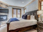 Grand master bedroom with king bed, fireplace, LED Smart TV, private deck & full bathroom