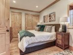 Second master bedroom suite with king bed, LED Smart TV, fireplace, and full private bathroom