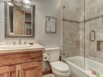 Second master suite bathroom with stone shower/tub and vanity