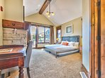 Upstairs Master Suite with King Bed, TV, Gas Fireplace, Deck Access and Private Bath