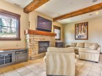 Lower Level Living Room with Comfortable Seating, TV, Gas Fireplace and Patio Access.