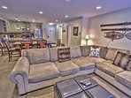 View of kitchen, dining area, & living room with fireplace and 47' HD TV/DVD with Wii & Xbox in Snowblaze 208 - Park...