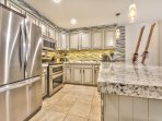 Newly Remodeled Kitchen with Stainless Steel Appliances, Travertine Floors, Granite Countertops and Plenty of Cupboard...