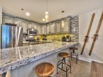 Newly Remodeled Kitchen with Stainless Steel Appliances, Travertine Floors, Granite Countertops and Bar Seating for 3