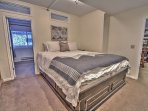 View of master bedroom with NBA king bed, private bathroom, and 32' HD Smart TV/DVD in Snowblaze 208 - Park City