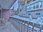 View of private covered patio with outdoor seating and BBQ grill at Snowblaze 208 - Park City