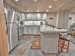 Newly Remodeled Kitchen with stainless appliances, full kitchen, Granite counters, and bar seating in Snowblaze 302...