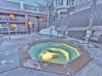 Pool area with gas fire pit and large hot tub at Snowblaze - Park City