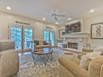 Main Level Living Room with 60' Smart TV/4K BluRay 3D DVD, Cozy Furnishings, Wood Fireplace and Private Deck with...