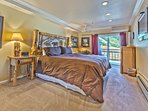 Master Bedroom with King Bed, Full Private Bath, Flat Screen TV, an LG A/C Unit, Sitting Area, and Deck Access with...