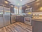 Fully Equipped Kitchen with Stainless Steel Appliances, Quartz Countertops and 5-Burner Gas Stove