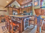 Entry to Upper Level Great Room with a Fully Equipped Kitchen, Bar Seating, a Wine Refrigerator, Dining area and Living...