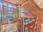 Fully Equipped Kitchen with Granite Countertops, Stainless Steel Appliances, Wine Refrigerator and Bar Seating for 4