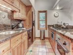 Fully Equipped Kitchen with Thermador Oven, 4-Burner Gas Stove and Bar Seating for 4