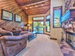 Living Room with Large Flat Screen TV, a Large Sectional Queen Sleeper Sofa, Gas Fireplace and Private Deck