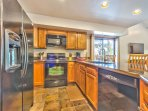 Spaciou Kitchen with stainless steel appliances and bar seating for 4