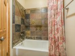 Upper Level Shared Separate 3-Piece Bathroom with a Tub/Shower