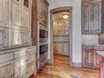 Fully Equipped Gourmet Chef's Kitchen with Double Wall Ovens and Large Pantry