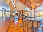 Spacious Gourmet Kitchen with Viking, Wolf and Sub Zero Appliances, Granite Counters, Bar Seating for 7