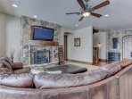 Lower Level Living Area with  Kitchen, 42' HD Smart TV, Gas Fireplace and Patio Access