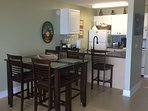 Spacious dining/kitchen area with breakfast bar.