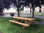 Picnic tables and charcoal grills also available throughout property.