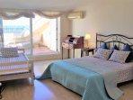 Bedroom I: 1 double bed, 3 single beds, terrace, air conditioner, en suit.
