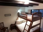 The second bedroom has bunk beds with a double below and a single above.