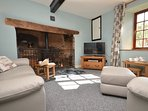 Relax by the woodburner in the lounge